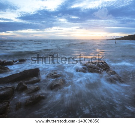 Beautiful sunset and sea waves  of the natural