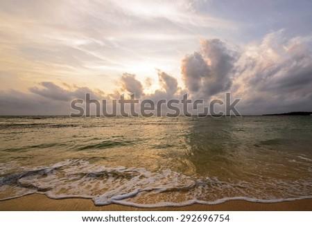 Beautiful sunset and waves, Okinawa, Japan - stock photo