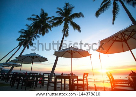 Beautiful sunset at a beach resort in the tropics. - stock photo