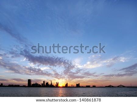 Beautiful sunset at Bahrain skyline - stock photo