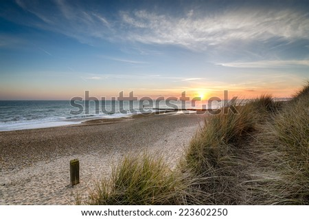 Beautiful sunset at Hengistbury Head beach near Bournemouth in Dorset - stock photo