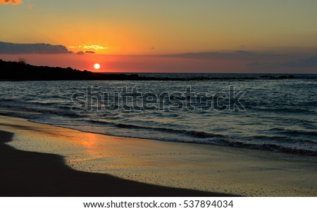 beautiful sunset at Mauna Kea beach Big Island of Hawaii
