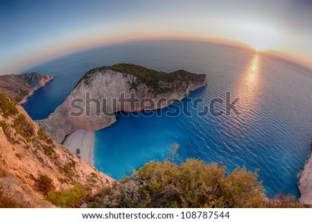 Beautiful sunset at Navagio Bay in Zakynthos, Greece, the place of the most known shipwreck in the world - stock photo