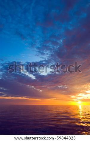 Beautiful sunset at Pacific ocean - stock photo
