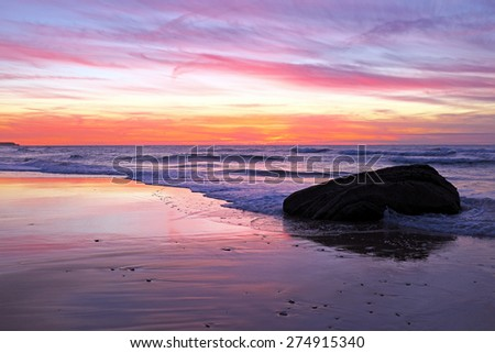 Beautiful sunset at praia Vale Figueiras in Portugal - stock photo