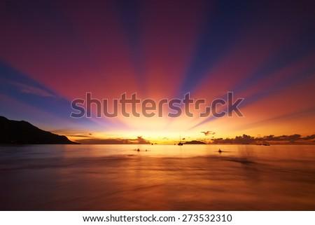 Beautiful sunset at Seychelles beach, Mahe - stock photo