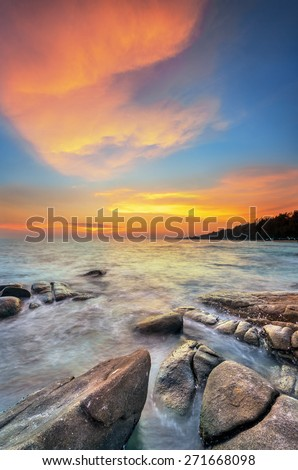 beautiful sunset at the beach - stock photo