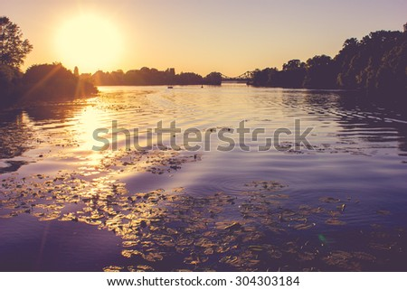 Beautiful Sunset at the Lakeshore - stock photo