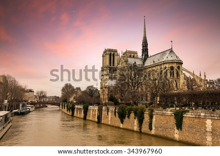 Beautiful sunset at the river Seine with the Notre-Dame Cathedral in Paris  - stock photo