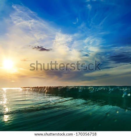 Beautiful sunset at the sea at south summer coast and colorful green blue wave line - stock photo