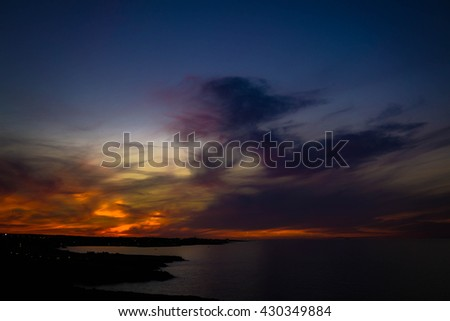 Beautiful sunset at the sea. Sea and rocks. Summer in Polignano A Mare, Bari, Puglia region, Italy. Mesmerising & Scenic - stock photo