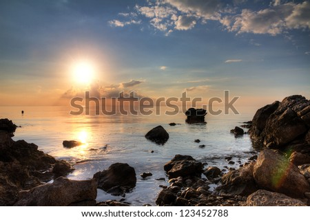 Beautiful sunset at the shores of Pag, Croatia. HDR - stock photo