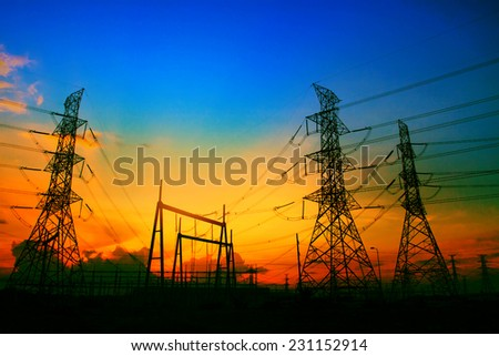 beautiful sunset behind electricity plant industry estate use as electrical power background  - stock photo