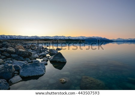 Beautiful sunset by the lake known as Lake Pukaki, located in south island, New Zealand. Nature composition,grain and noise effect,soft focus and vibrant colours.