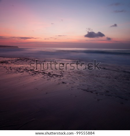 Beautiful sunset by the ocean in Bali - stock photo