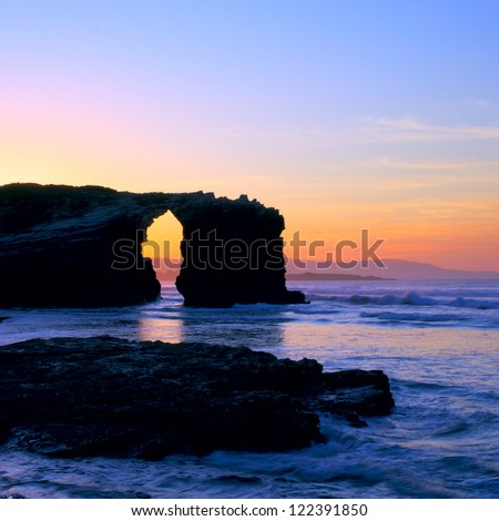 Beautiful sunset by the ocean in Cathedral beach. Galicia, Spain - stock photo