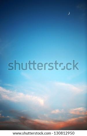 Beautiful sunset , deep blue sky and moon - stock photo