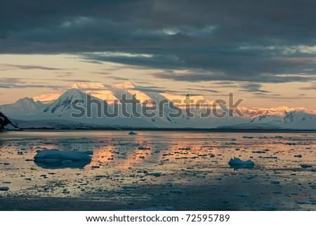 Beautiful sunset in Antarctica - stock photo