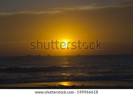 Beautiful sunset in Cala Conta, Ibiza Beautiful sunset in Cala Conta, Ibiza, near San Antonio.  - stock photo