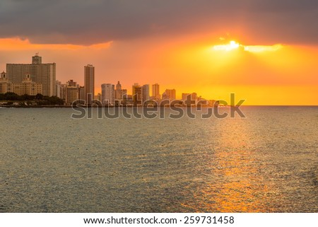 Beautiful sunset in Havana with reflections on the ocean - stock photo