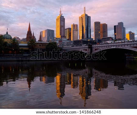 Beautiful sunset in Melbourne reflected in the Yarra river - stock photo