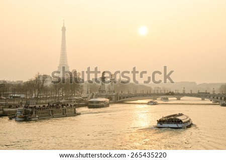 Beautiful sunset in Paris overlooking the Seine and the Eiffel tower - stock photo