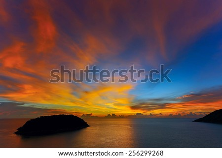 Beautiful sunset in promthep cape is a mountain of rock that extends into the sea in Phuket - stock photo