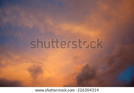 Beautiful sunset in red clouds before the storm - stock photo