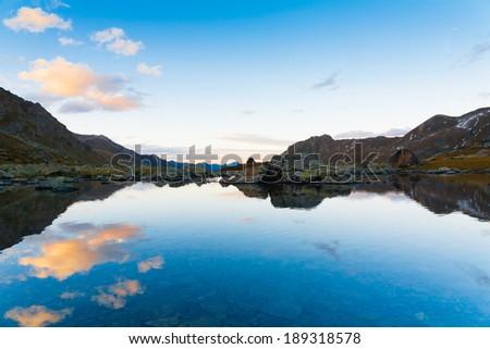 beautiful sunset in the autumn lake of the mountain - stock photo