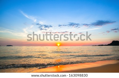 Beautiful sunset in the sea. - stock photo