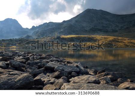 beautiful sunset landscape at Bucura Lake - stock photo