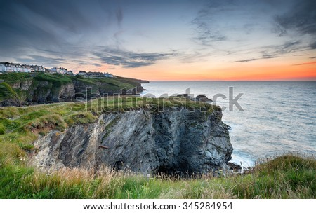 Beautiful sunset looking out at clifftop houses at Port Isaac on the rugged north Cornwall coast