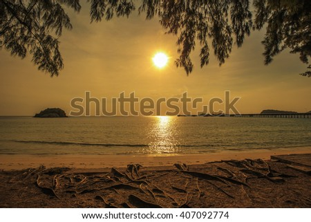 Beautiful sunset looking out from Nang ram Beach,Thai gulf,Sattahip,Chonburi,Thailand - stock photo