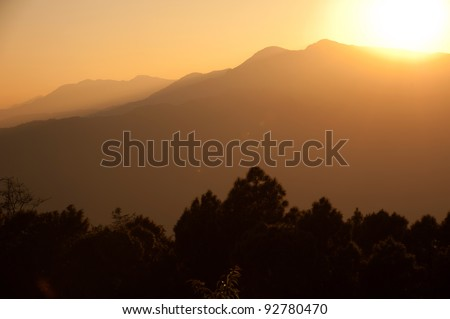 Beautiful sunset of the Himalayan mountains when see from Sarangkot, Pokhara, Nepal - stock photo