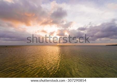 Beautiful sunset of the sea, Okinawa, Japan - stock photo