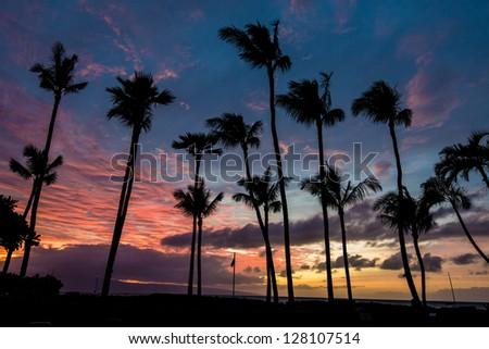 Beautiful sunset on a calm day in Maui Hawaii - stock photo