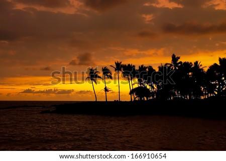 Beautiful sunset on Hawaii tropical beach - stock photo
