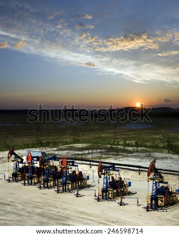 Beautiful sunset on oil extraction field in West Siberia. Russia oil and gas industry. Business and nature - stock photo