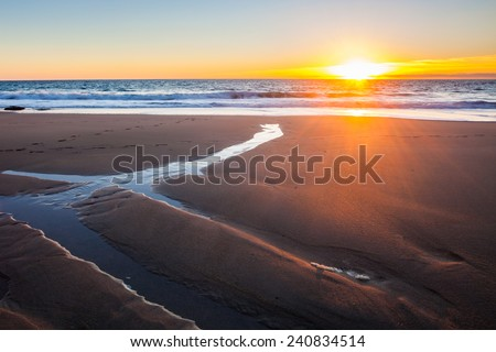 Beautiful sunset on Porthcew beach at Rinsey Cove Cornwall England UK Europe - stock photo
