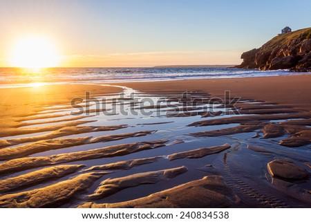 Beautiful sunset on Porthcew beach at Rinsey Cove Cornwall England UK Europe - stock photo
