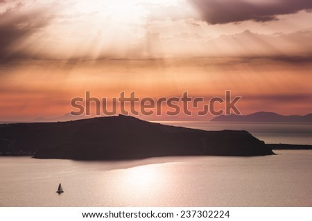 Beautiful sunset on Santorini island, Greece. Summer landscape with sea view