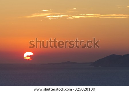Beautiful sunset on the Aegean sea  and the mountains of Folegandros island, Greece 2013.