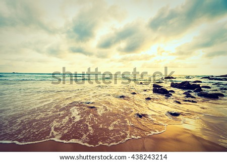 Beautiful sunset on the beach and sea with cloud and sky background - Vintage Filter