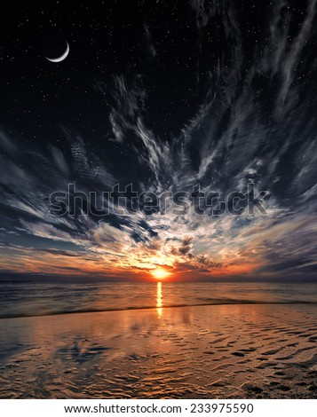 Beautiful sunset on the beach, stars and moon on the sky - stock photo