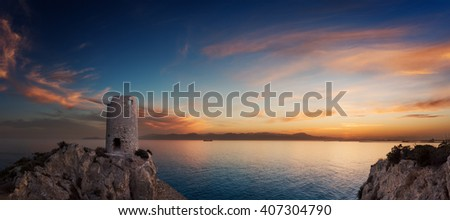 Beautiful sunset on the coast with an ancient wachtower in Cagliari - Sardinia.