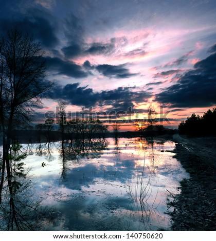 beautiful sunset on the lake - stock photo