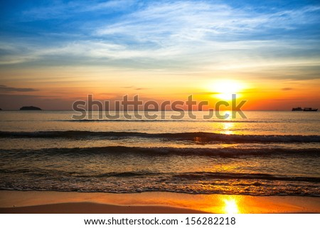 Beautiful sunset on the sea beach. - stock photo