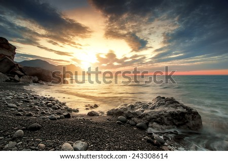 beautiful sunset or sunrise on beach, natural summer background  - stock photo