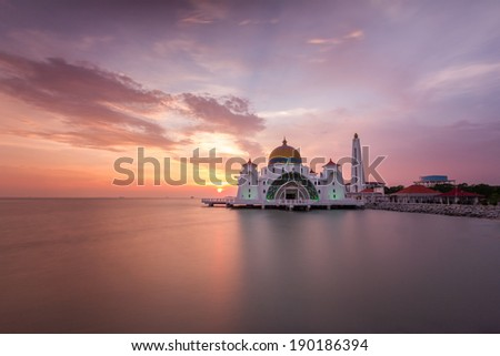 Beautiful sunset over a mosque with stunning cloud