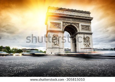 Beautiful sunset over Arc de Triomphe at Place de l'Etoile, Paris - stock photo